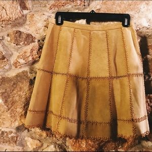 Leather patchwork mini-skirt. Light brown.